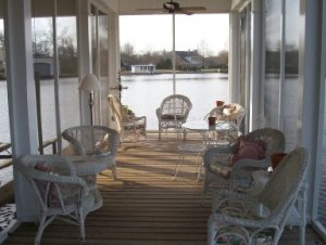 Beautiful screened in area of boathouse - designed by Carolyn Barnes, Monroe, Louisiana; Built by Vines Piers, Inc., Delhi, Louisiana